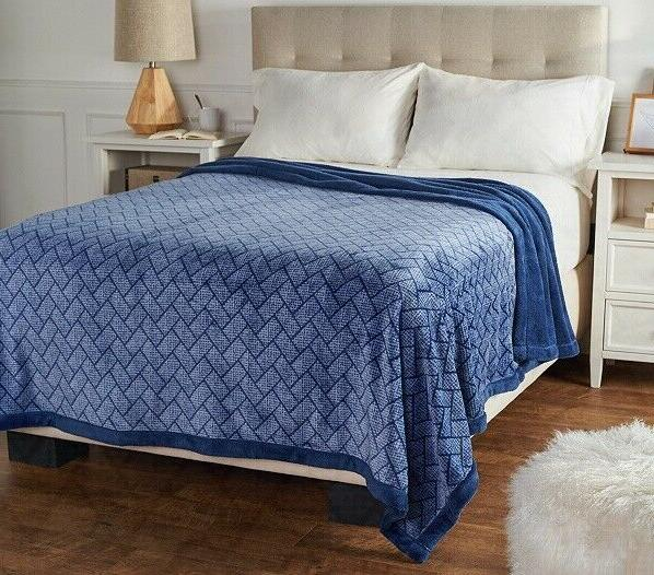 king woven print reverse to solid blanket